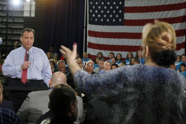 New Jersey Gov. Chris Christie listens to Carol Raab Davis of Toms River, during a town hall meeting in Brick Township, N.J., Thursday. (AP Photo/Mel Evans)