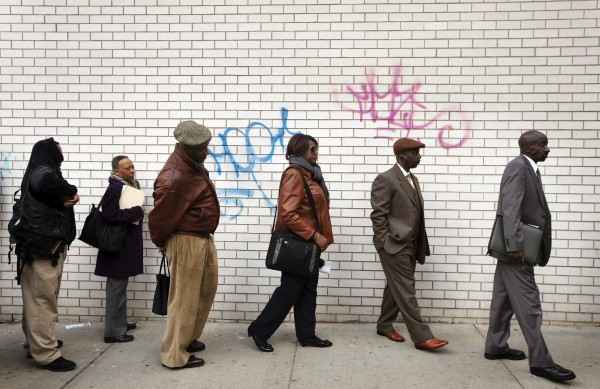 obseekers stand in line to attend the Dr. Martin Luther King Jr. career fair held by the New York State department of Labor in New York.  (REUTERS/Lucas Jackson)