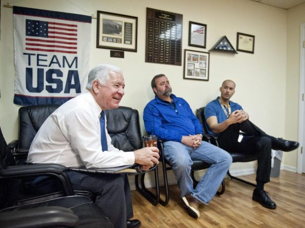 Rep. Nick Rahall , left, speaks with staff members at the Princeton Veterans Center in Princeton, W.Va. (AP Photo/Michael Shroyer)