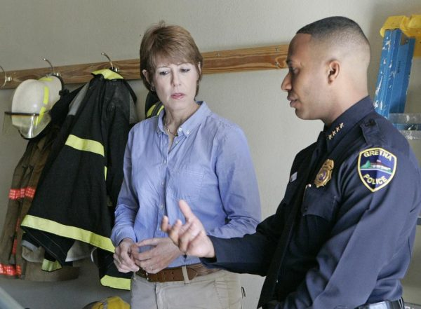 U.S. House candidate Gwen Graham listens to Police Chief and public safety director Carlos De La Cruz as he explains the workings of his department in Gretna, Fla.  (AP Photo/Steve Cannon)