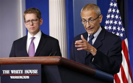 White House senior counselor John Podesta (R) speaks to reporters in the White House briefing room. (REUTERS/Kevin Lamarque )