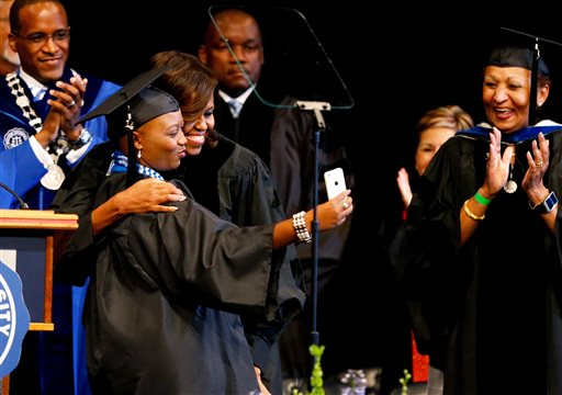 Senior class president Nicole A. Tinson takes a selfie with first lady Michelle Obama during Dillard University's commencement ceremony.  (AP Photo/Jonathan Bachman)
