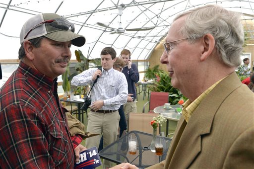 Darrell Uhls, left, shakes hans with Kentucky Republican senatorial candidate Mitch McConnell during a campaign stop Saturday at the Tanglewood Farms Restaurant in Franklin, Ky. (AP Photo/Timothy D. Easley)