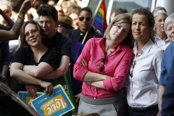 Viola Vetterm and her wife Kate Potalivo, and Amber Orion and her partner, Joy Payton listen to a speaker during a rally at City Hall in Philadelphia. Pennsylvania's ban on gay marriage was overturned by U.S. District Judge John E. Jones III on May 20. (AP Photo/Matt Slocum)