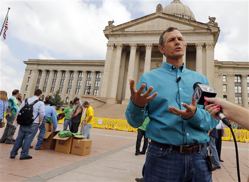 Chip Paul, chairman Oklahomans for Health, speaks with the media during a medical marijuana rally at the State Capitol.  (AP Photo/The Oklahoman, Steve Sisney)