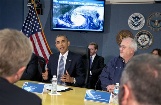President Barack Obama speaks at Federal Emergency Management Agency (FEMA) headquarters in Washington, Friday, during a hurricane preparedness meeting. at right is Federal Emergency Management Agency (FEMA) administrator Craig Fugate.  (AP Photo/Carolyn Kaster)