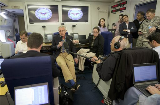 Defense Secretary Chuck Hagel, aboard a U.S. Military Aircraft   (AP Photo/Pablo Martinez Monsivais)