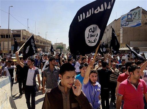 Demonstrators chant pro-al-Qaida-inspired Islamic State of Iraq and the Levant  (AP Photo)