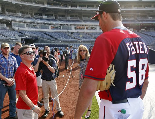 "Washington Nationals starting pitcher Doug Fister talks with U.S. Marine Corporal William ""Kyle"" Carpenter, second from left  (AP Photo/Alex Brandon)"