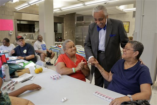 Rep. Charlie Rangel, D-N.Y., center, greets constituents at a community center in Harlem.  (AP Photo/Julie Jacobson)