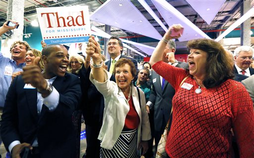 Supporters of U.S. Sen. Thad Cochran, R-Miss., break into cheer as he is declared the winner in his primary runoff for the GOP nomination for U.S. Senate   (AP Photo/Rogelio V. Solis)