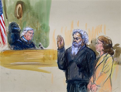 United States Magistrate, Judge John Facciola, swearing in the defendant, Libyan militant Ahmed Abu Khatallah (AP Photo/Dana Verkouteren)