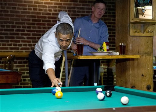President Barack Obama plays pool at Wynkoop Brewing Co. with Colorado Gov. John Hickenlooper  (AP Photo/Jacquelyn Martin)