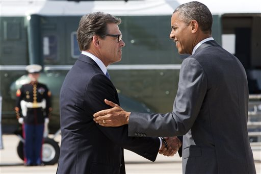 President Barack Obama, right, and Texas Gov. Rick Perry shake hands as Obama arrives in Dallas where they will attend a meeting about the border and immigration together, Wednesday. (AP Photo/Jacquelyn Martin)