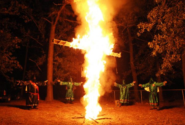 Members of the Ku Klux Klan (KKK) participate in a cross lighting ceremony  (REUTERS/Rainier Ehrhardt)