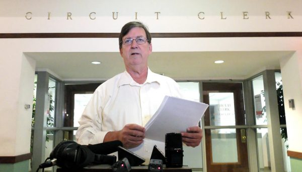 Hinds County Republican Party chairman Pete Perry tells reporters 300 to 350 possible illegally cast votes were found in Mississippi's largest county in the Senate runoff  (AP Photo/Rogelio V. Solis)