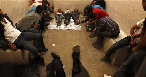 Immigrants who have been detained while crossing the border  are held inside the McAllen Border Patrol Station in McAllen, Texas   (AP Photo/Los Angeles Times, Rick Loomis, Pool)