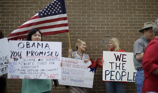 Protesters gather outside the Mexican Consulate  (AP Photo/Eric Gay)