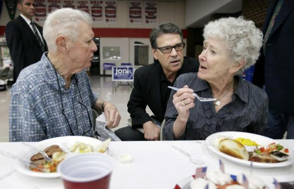 Texas Gov. Rick Perry talks with Dick Dale, left, and his wife Margurite, right, of Algona, Iowa  (AP Photo/Charlie Neibergall)