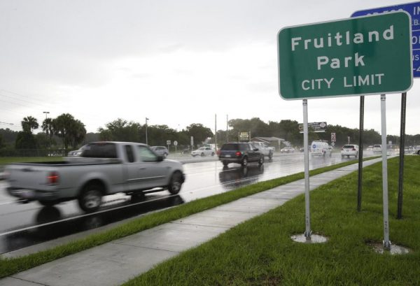 Cars pass by on a six lane highway that runs through Fruitland Park, Fla.  (AP Photo/John Raoux)