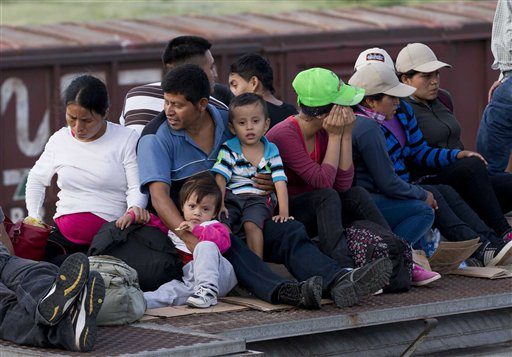 Central American migrants ride a freight train during their journey toward the U.S.  (AP Photo/Eduardo Verdugo)