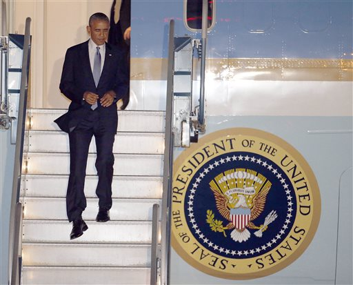 President Barack Obama walks down the stairs of Air Force One (AP Photo/Tony Avelar)
