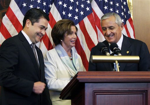 House Democratic Leader Nancy Pelosi, D-Calif., center, is seen with Guatemalan President Otto Molina, right, and Honduran President Juan Hernández Thursday  (AP Photo/Lauren Victoria Burke)