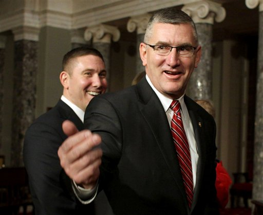 FILE - In this Feb. 11, 2014, file photo, Sen. John Walsh, D-Mont., right, and his son Michael leave the Old Senate Chamber (AP Photo/Lauren Victoria Burke)