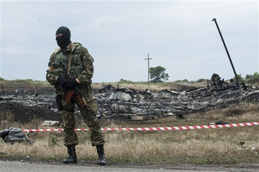 Pro-Russian fighter guarding the crash site of Malaysia Airlines Flight 17  (AP Photo/Evgeniy Maloletka)