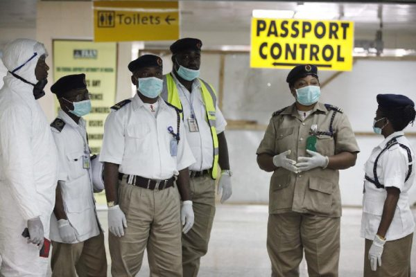 Nigeria health officials wait to screen passengers at the arrival hall of Murtala Muhammed International Airport in Lagos, Nigeria, Monday  (AP Photo/Sunday Alamba)