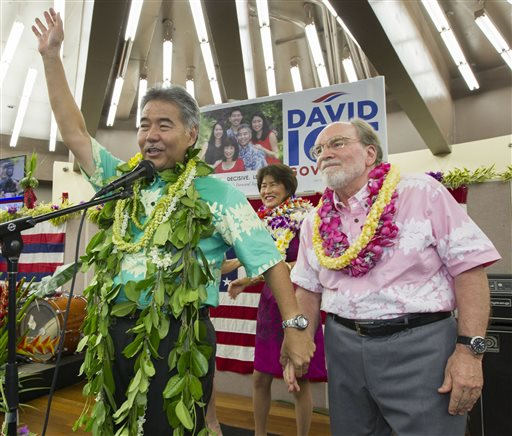 Hawaii State Sen. David Ige, right, waves to his supporters and thanks Hawaii Governor Neil Abercrombie, right (AP Photo/Eugene Tanner)