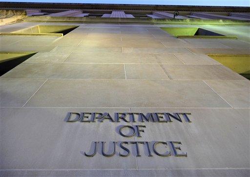 FILE - This May 14, 2013 The Justice Department in Washington (AP Photo/J. David Ake)