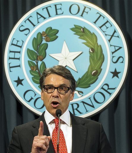 Texas Gov. Rick Perry speaks during a news conference on Saturday, n Austin, Texas.  (AP Photo/Austin American-Statesman, Rodolfo Gonzalez)