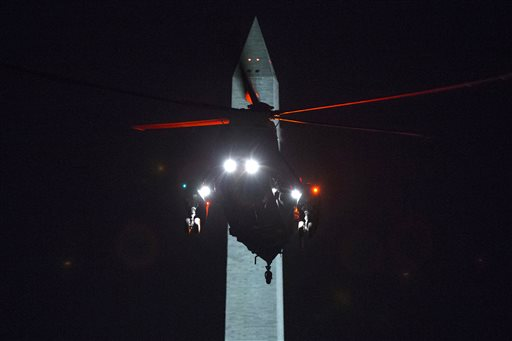 Marine One carrying President Barack Obama arrives on the South Lawn of the White House on Monday  (AP Photo/Evan Vucci)