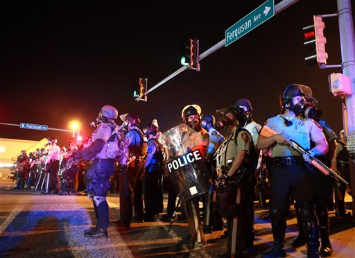 Police stand guard Monday, Aug. 18, 2014, in Ferguson, Mo.  (AP Photo/St. Louis Post-Dispatch, Christian Gooden)