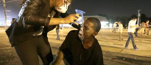 Justice Dept. seeks truth, calm in uneasy Ferguson