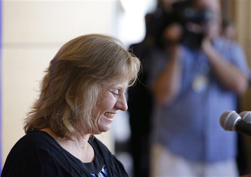 Debbie Sacra, wife of Dr. Rick Sacra  (AP Photo/Stephan Savoia)