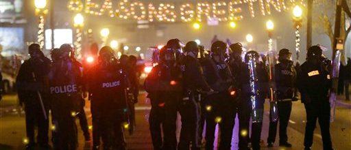 Fires of protest burn again in Ferguson