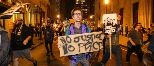 Thousands rally across nation after Ferguson decision