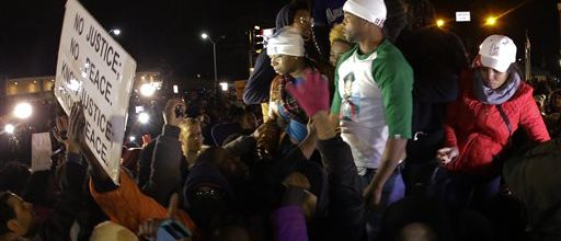 Michael Brown's stepfather apologizes for comments