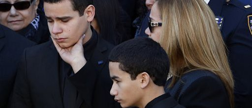 Tension, crowds at NYPD funeral