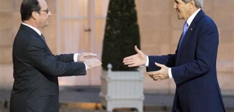 Kerry tries to make U.S. amends in Paris