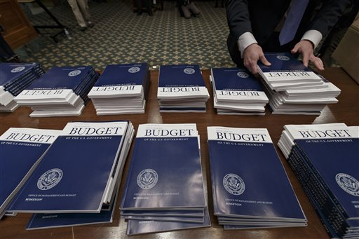Deficit down, health insurance up for Obama