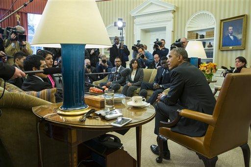 Federal judge halts Obama's immigration plan