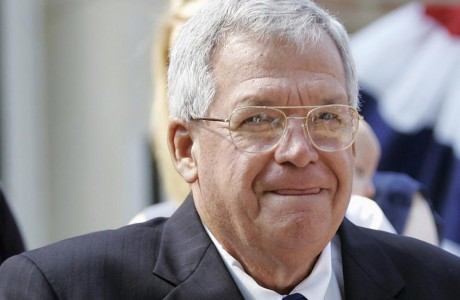 What scandal was Hastert trying to hide?