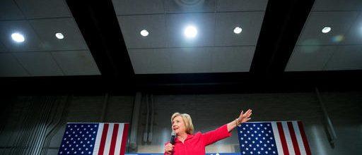 Clinton pours millions into battlegrounds