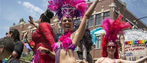 Gays celebrate, mourn in parades