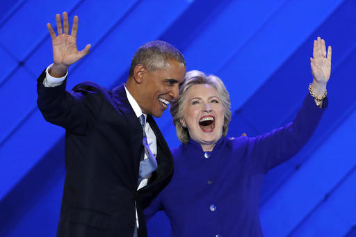 Obama passes baton to Clinton
