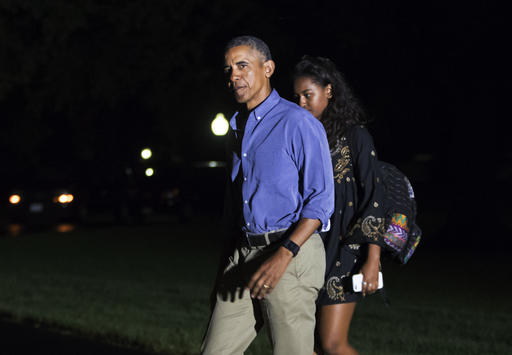 President Barack Obama, followed by daughter Sasha Obama, returns from a 16-day vacation to Martha's Vineyard, Mass., arriving at the White House in Washington, late Sunday, Aug. 21, 2016. (AP Photo/J. Scott Applewhite)