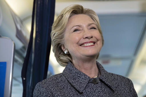 Democratic presidential candidate Hillary Clinton speaks with members of the media on her campaign plane at Chicago Midway Airport in Chicago, Thursday, Sept. 29, 2016. (AP Photo/Matt Rourke)